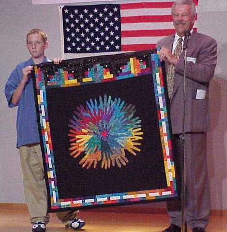 Packie and superintendent Lund present quilt in Otsuchi, Japan