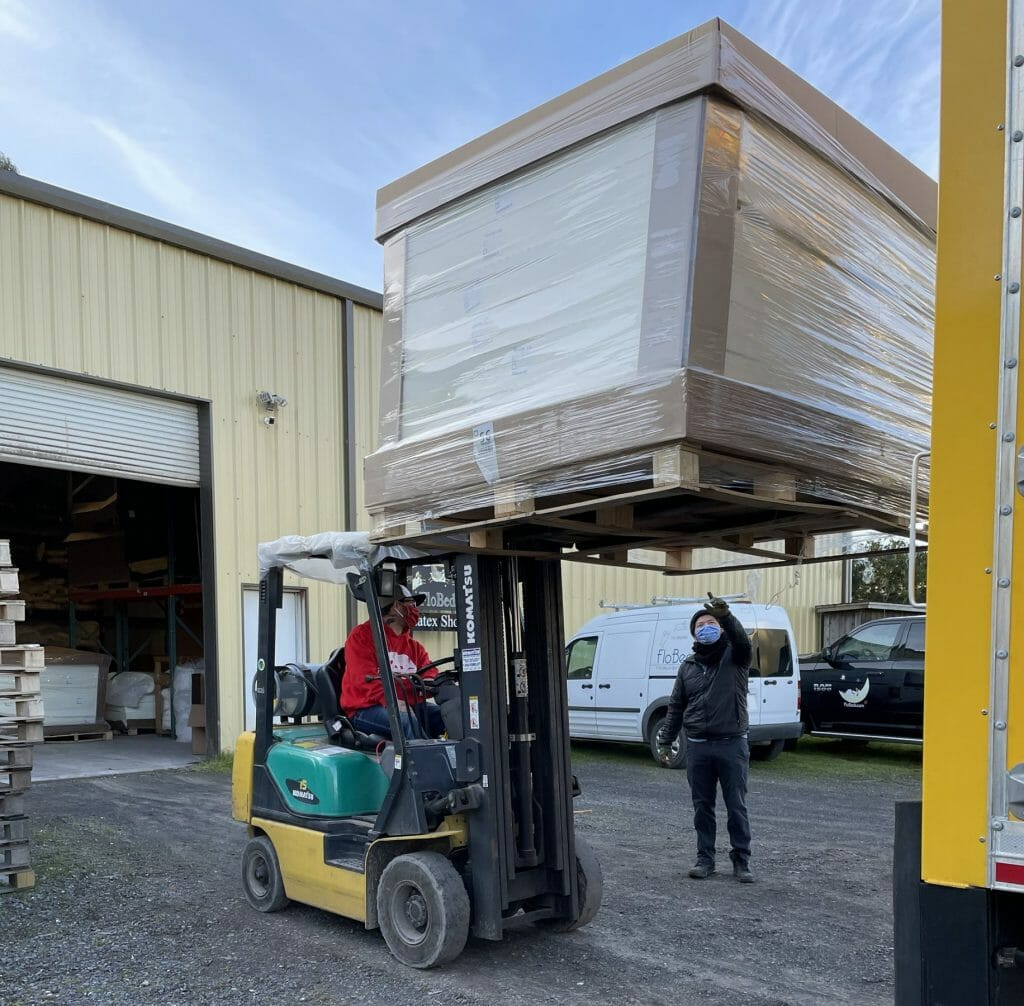 Russ and Paul unload emegency truck load of Talalay